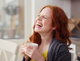 Woman laughing at a joke