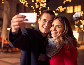 Happy couple taking a Christmas selfie