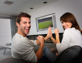 Couple watching rugby