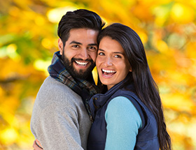 Happy Indian couple in the park